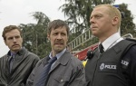 Rafe Spall (left), Paddy Considine (center) and Simon Pegg (right) co-star in Edgar Wright's new action comedy HOTFUZZ