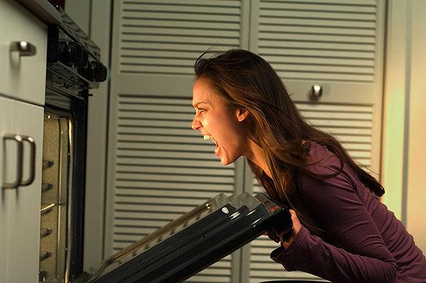 Jessica Alba yelling into stove